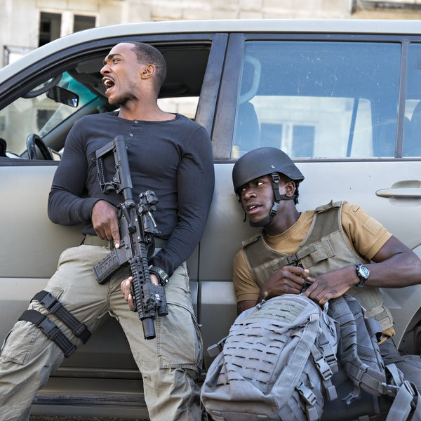 Anthony Mackie, as, Leo, Damson Idris as Harp, in OUTSIDE THE WIRE, Netflix